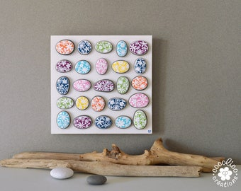 "25 pebbles painted ""spring flowers"" on wooden stand"