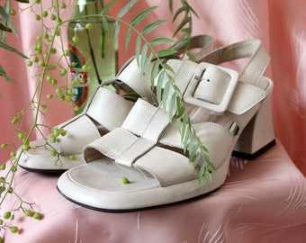 White high-heeled sandals with buckle 90s. 90s sandals. Heeled sandals. Square heel. Shoes 90s. 90s heels. Crabeater leather.