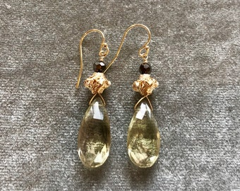 Grade A moss green Prehinite drops with 14kt gold filled beads and black crystal drop earrings on 24kt gold vermeil French earrings