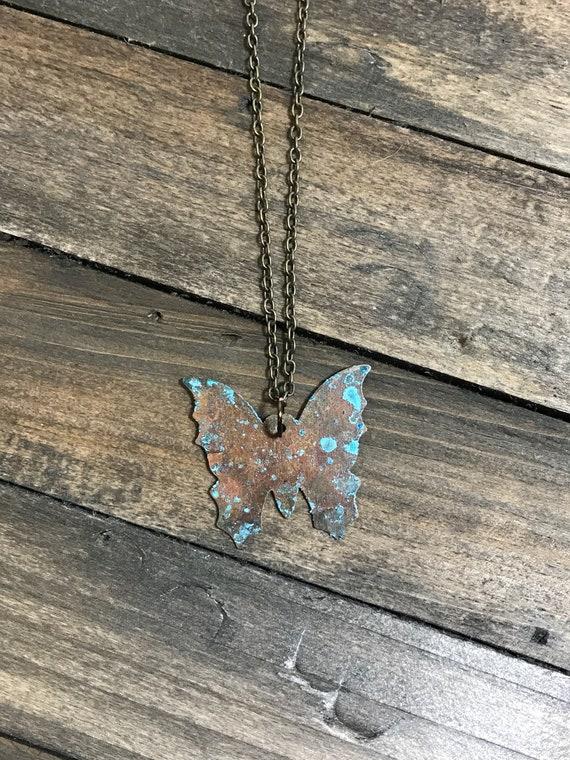 Rustic brass patina butterfly pendant