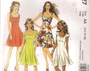 McCall's M6027 Flared Dress Short Sleeve Or Sleeveless Summer Sewing Pattern 6027 UNCUT Size 6, 8, 10, 12