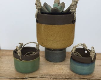 Round ceramic hanging planters for succulent or cactus with a volcanic blue/grey glaze, green, yellow or blue.