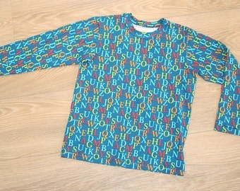 organic cotton jersey shirt teal, ABC print in green, red, orange and turquoise