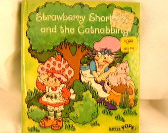 Vintage Strawberry shortcake and the catnabbing popup book