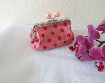 retro purse with pink polka dots with clasp