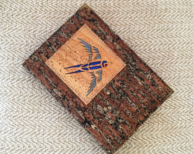 Swooping blue bird applique on a cork and fennel cover with an A6 notebook with lined or  plain art paper