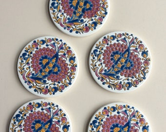 5 round ceramic tiles/coasters. Made by Niarchos