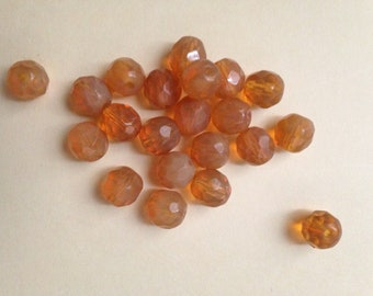 Vintage 10mm faceted round glass beads each in a mixture of clear and matte topaz.