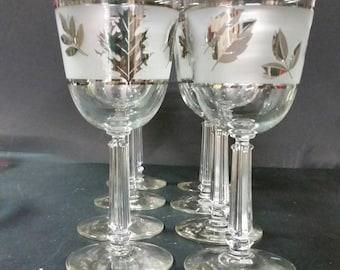 Long stem wine or water glasses.  Gold leaf design.  Set of 8
