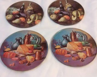 Vintage set of 4 coasters. Metal with cork bottom.