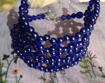 Cufflinks round beads and blue