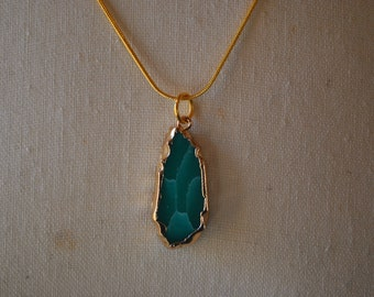 Gold and precious stone necklace