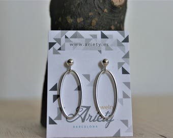 Long earrings in sterling silver and zamak ovals