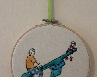 Father and Daughter on See-Saw in an Embroidery Hoop