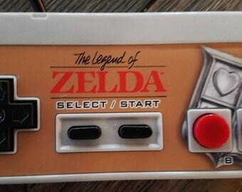 NES Controller with Zelda Overlay