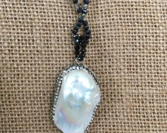 20 inch black crystal necklace with a Baroque pearl focal pendant.