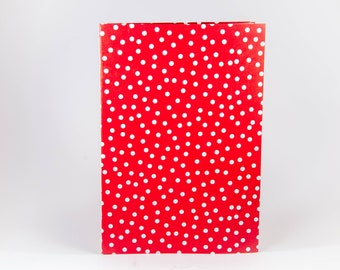 Red notebook with white polka dots.
