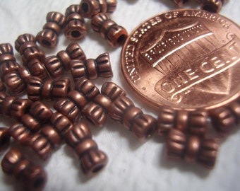 Tiny Antique Copper Bow Spacers 30