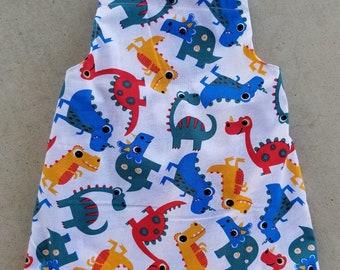Little boy dinosaur print romper with blue straps and trim