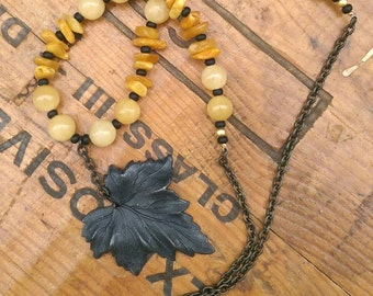 New! Butterscotch Amber and butter Jade beaded necklace. Antique black brass leaf pendant.
