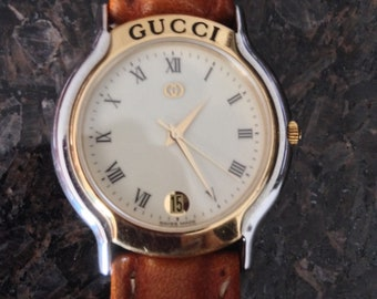 Watch by Gucci.  Authentic