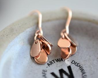 Dangling rose gold earring. Rose gold coin earring. Rose gold disc earring. Rose gold teardrop earring. Gold drop earring.