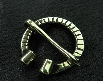 Small brass penannular Viking brooch