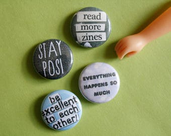 "1"" inch buttons / be excellent to each other / read more zines / everything happens so much / stay posi"
