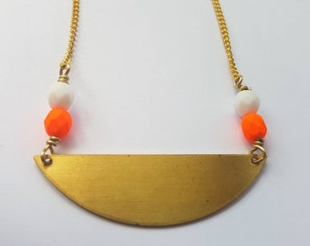 Half moon brass necklace with orange and white accent beads