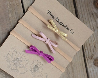 Bow set in Magenta, gold, and pink dainty bows