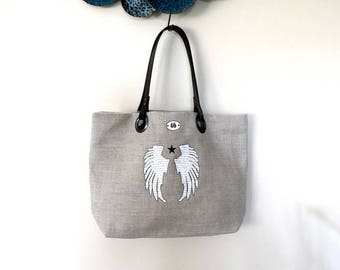 Angel wings and star linen tote bag