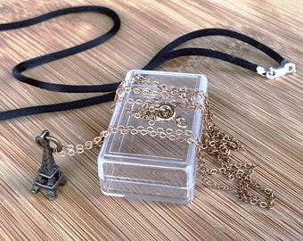 Brass charm with two ways to wear: a brass chain and silk cord necklace