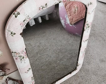 Antique french napolean mirror bathroom covered in vintage pink floral wallpaper chippy screen shabby Nordic chic Rachel Ashwell