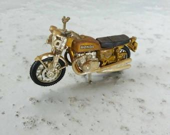 Vintage model motorcycle - Honda - mini version - 70's - made in Macau - retro style - golden colour