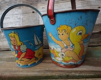 2 Vintage sand pails buckets Eagle Toys colorful boy girl Seahorse Rubber duck sailboat beach lake house garden