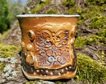 Sassy woodfired tumbler. Thrown and altered piece.