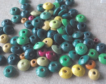 Set of wooden round and semi-plates, painted wood beads
