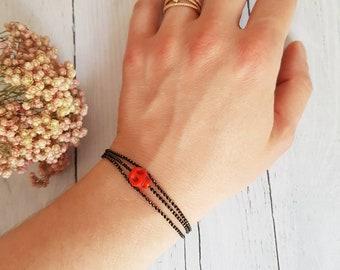 Skull Bracelet: Red Skull bracelet triple Tower in black and gold chain