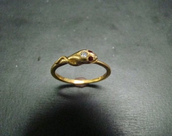 Very sweet 14K gold snake ring with diamond and ruby eyes