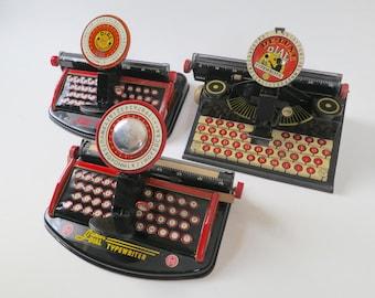 Three Marx Tin Litho toy typewriters