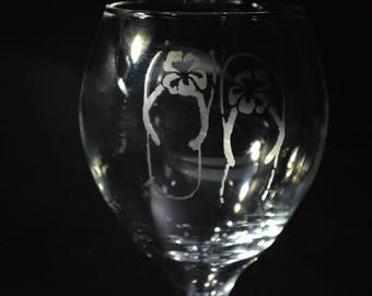 Sandals in the sun Etched Wine Glass