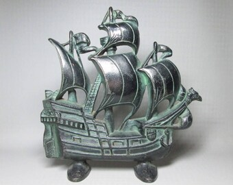 Creation cast iron ship doorstop dated 1930 , painted black and green to give it an aged bronze look ( vintage / antique )