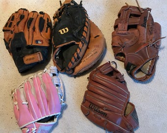 Wilson catchers mitt and baseball mitts gloves used leather