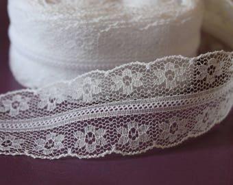 Beautiful fine lace and delicate white ribbon