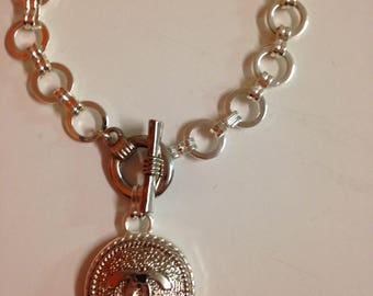 Repurposed  button into chain bracelet silver tone color
