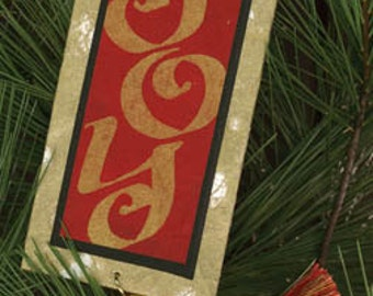 Joy, a hand-crafted ornament with archival matboard; made of approximately 70% recycled material