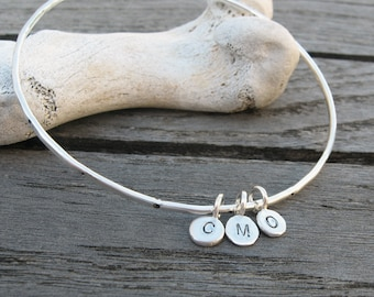 Personalized sterling silver bangle hammered and dotted with 3 custom initial tags by VisionQuest