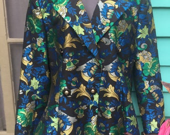 A sixties floral brocade jacket in blues,greens,golds and black from Bergdorf Goodman