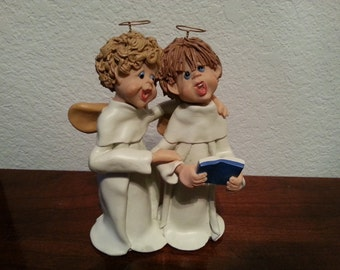 Two Angels with Halos Singing Figurine