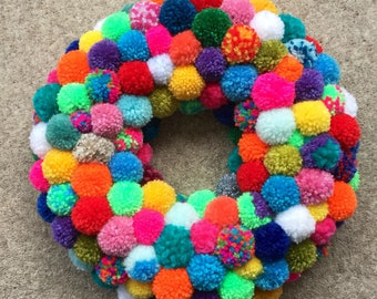 Multicoloured Pom Pom Wreath.